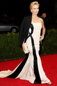 Charlize Theron wore a Dior Couture gown with a tuxedo jacket, Jimmy Choo sandals and Fred Leighton jewellery.