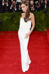 Victoria Beckham wore a white column dress of her own design with Jacob & Co. jewellery.
